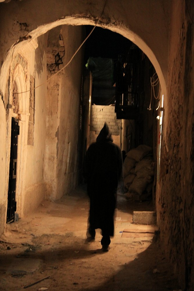 A Marrocan immigrant is wandering in the narrow alleys of the old town.